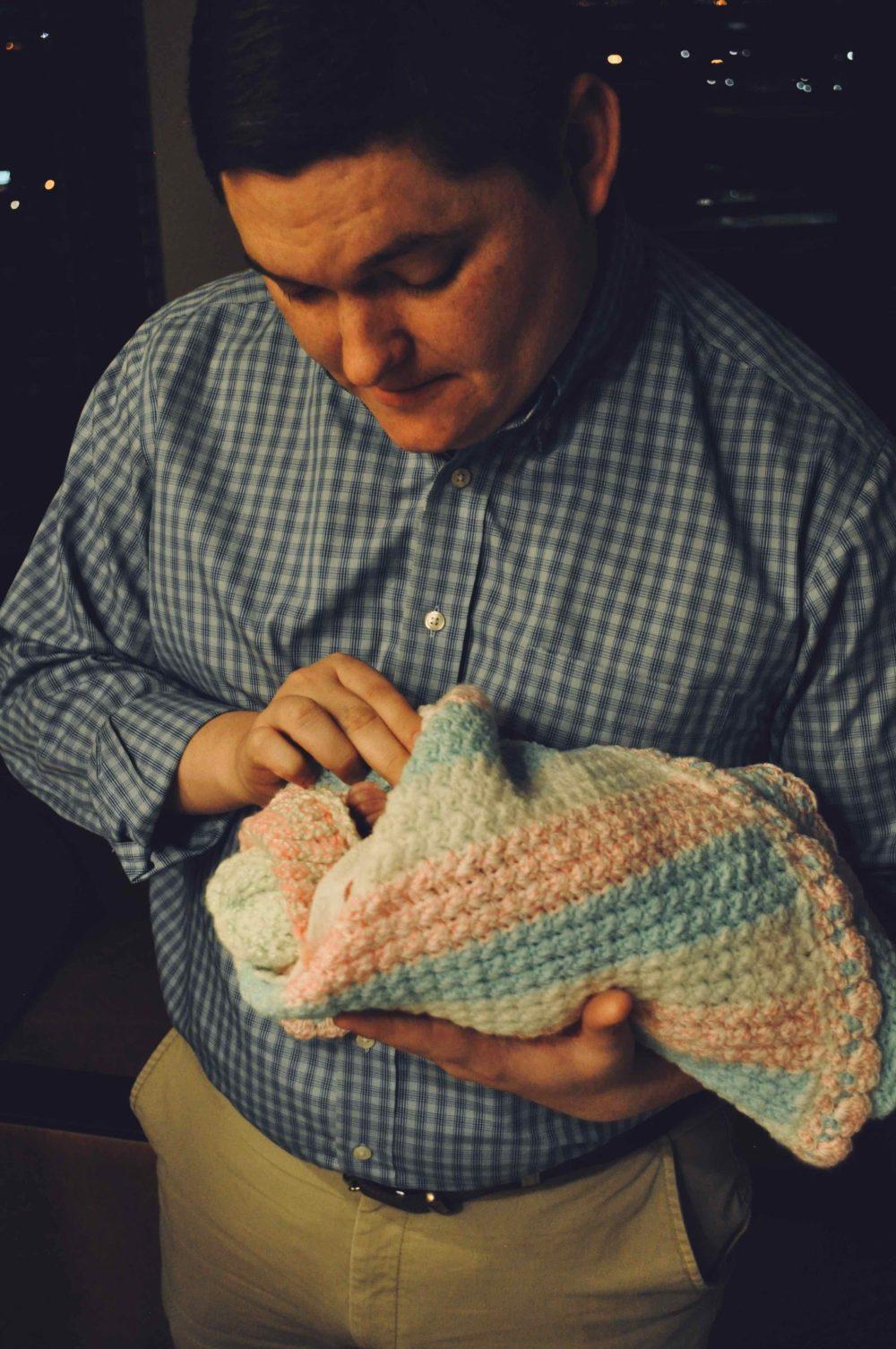 Robert holding Harper at her birth.