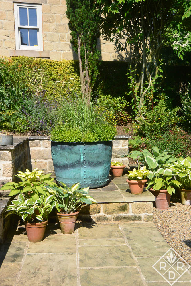 Antique copper pot used as a very large container. The owners were thrilled to get one that was so large.