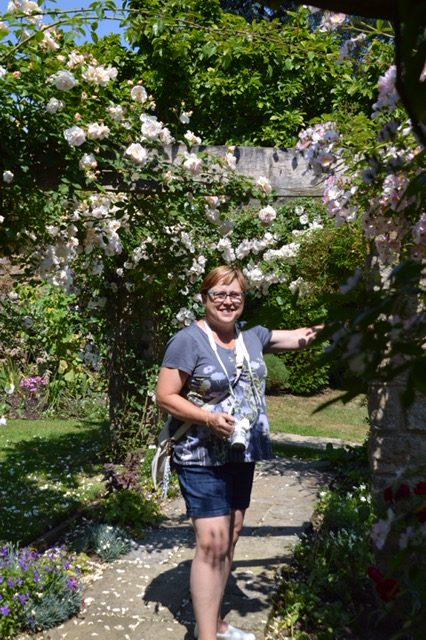 Layanee DeMerchant took this photo of me in Pamela's garden. I think it's fun!