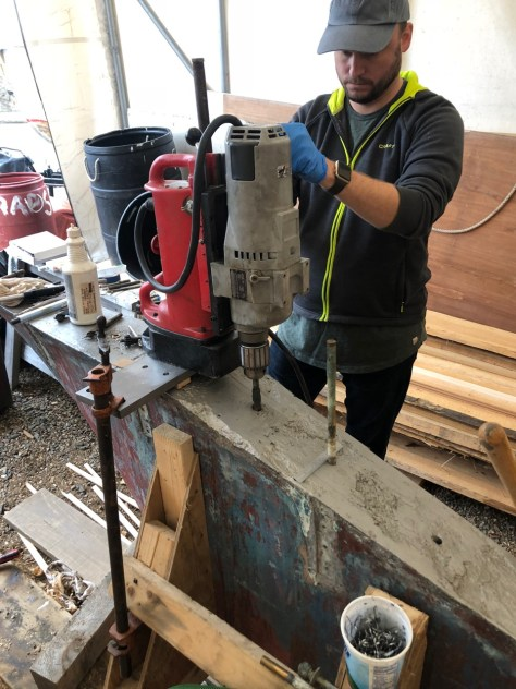 the magnetic drill is set on a scrap steel plate and clamped gto the keel this gave us a strong sturdy base and allowed us to drill accuratly at the correct point and angle.
