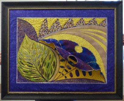 "Jan's framed ""Dynamic Directions"" piece."