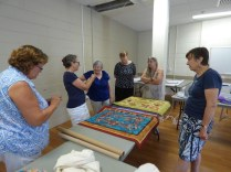 Sue showed a few early art quilts and a previous group challenge