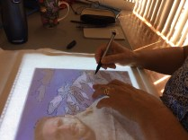 Di was tracing out her design on the light box - another portrait of her son.