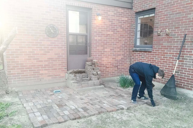 Mike Working on Brick Patio 2016