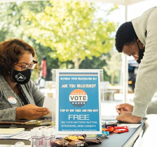 Student registering to vote on LR campus
