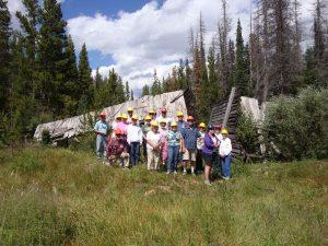 Tour participants in front of Stuck Creek Splash Dam