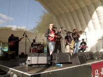 Dub from Atlantis on the main stage. The guitarist is in the foreground singing, backed by horns, keys, bass and drums