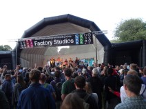 Band playing on the main stage in the early evening