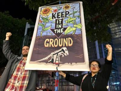 Daniel Ilario and María De Lime Dorsey of Idle No More, San Francisco Bay, protest Jerry Brown's speech at the New York Times Climate Tech Summit in San Francisco. Photo courtesy of Idle No More, San Francisco Bay.