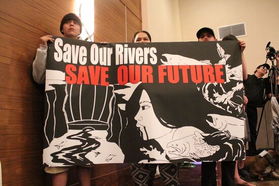 """""""Save Our Rivers, Save Our Future"""" sign help by Tribal Members from the Klamath River at the Delta Tunnel scoping meeting in Redding on March 2, 2020."""