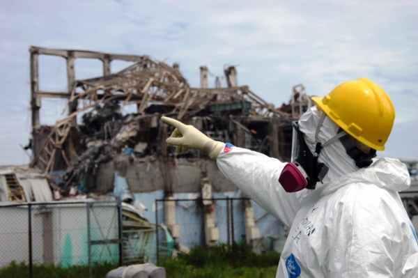 An International Atomic Energy Agency investigator examines Reactor Unit 3 at the damaged Fukushima Daiichi plant, May 27, 2011.