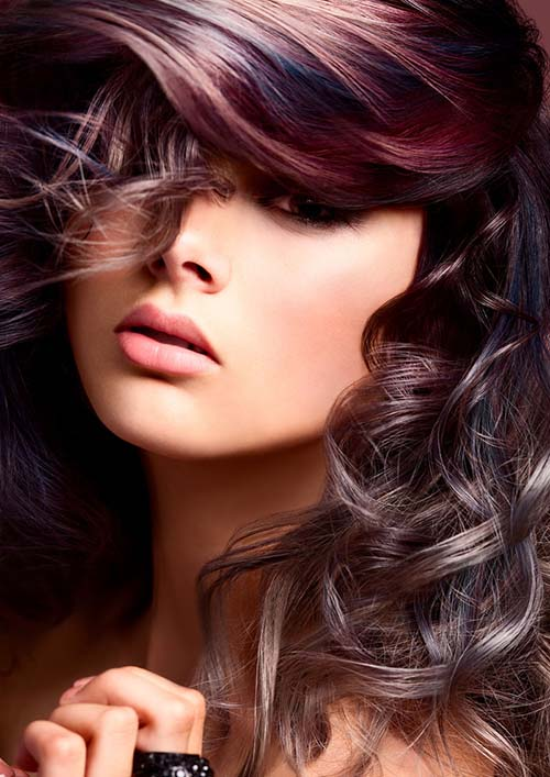 Aubergine hair color in long curly hair