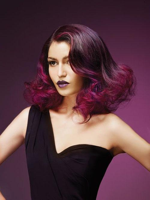 Curly vintage hairstyle with aubergine hair colors