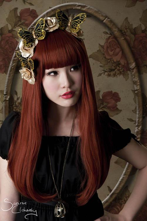 Long deep auburn straight hairstyle with bangs