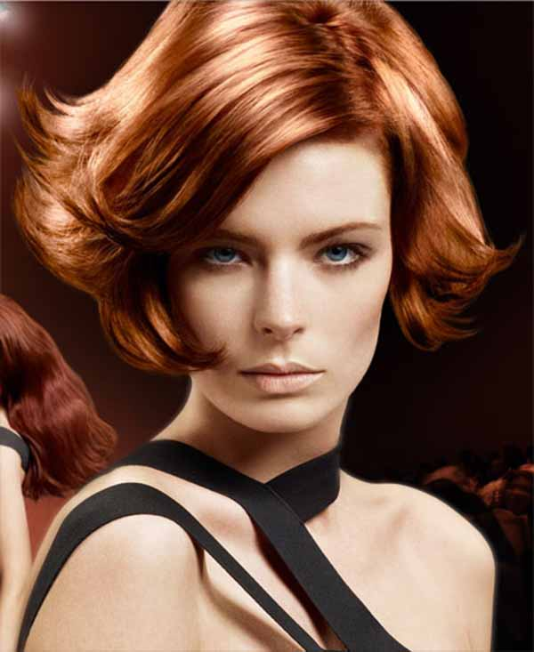 Short bob with side parting copper and high;lights hair color