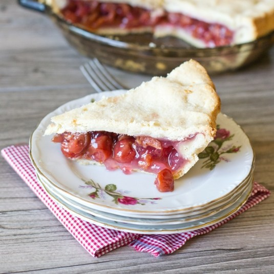 This is my Grandma's Sour Cherry Pie recipe. Simply the best cherry pie there is, and so easy to make with just 4 ingredients. We love eating it warm with ice cream on top.