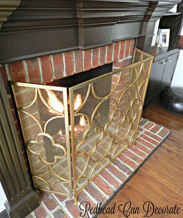 This gold fireplace screen is a gorgeous addition to any fireplace! It add a bit of elegance to the rather drab rustic fireplace.