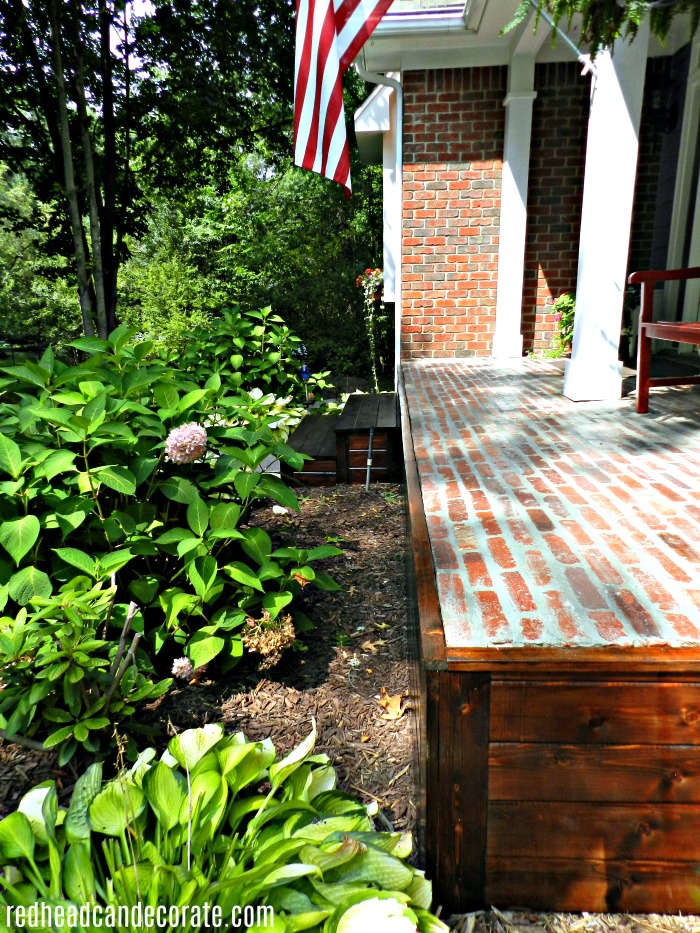 They covered up their old brick on their front porch with gorgeous wood!
