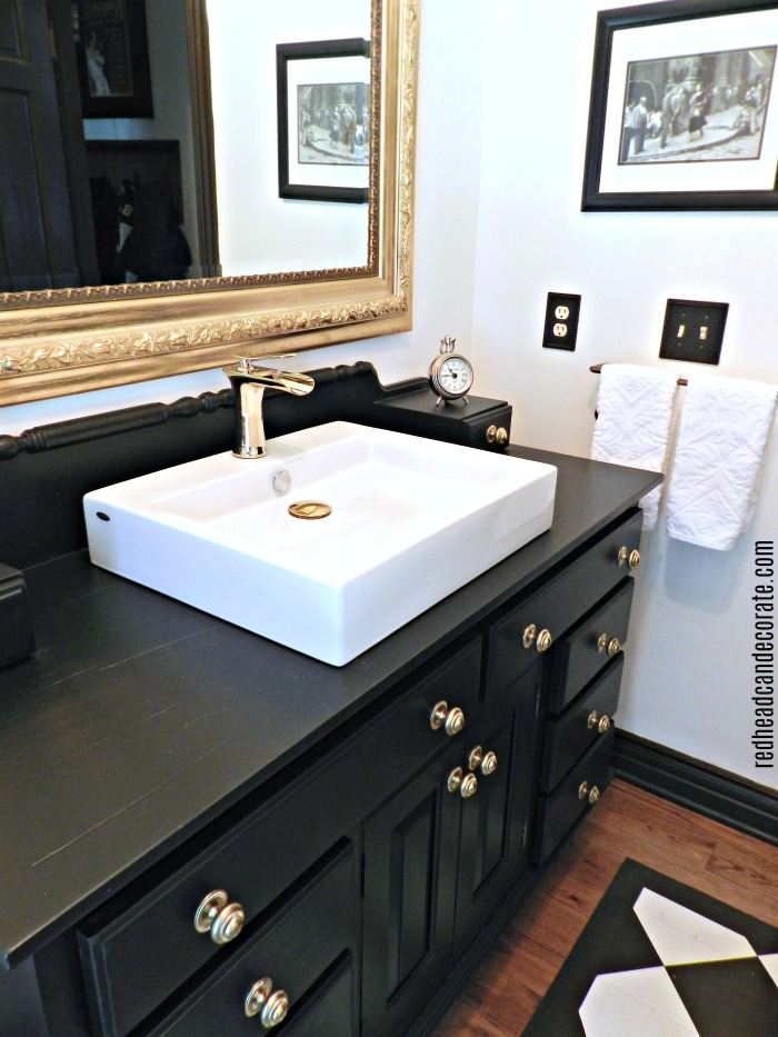 You have got to see this beautiful bathroom transformation from redheadcandecorate.com! She takes black & gold to a whole new level!
