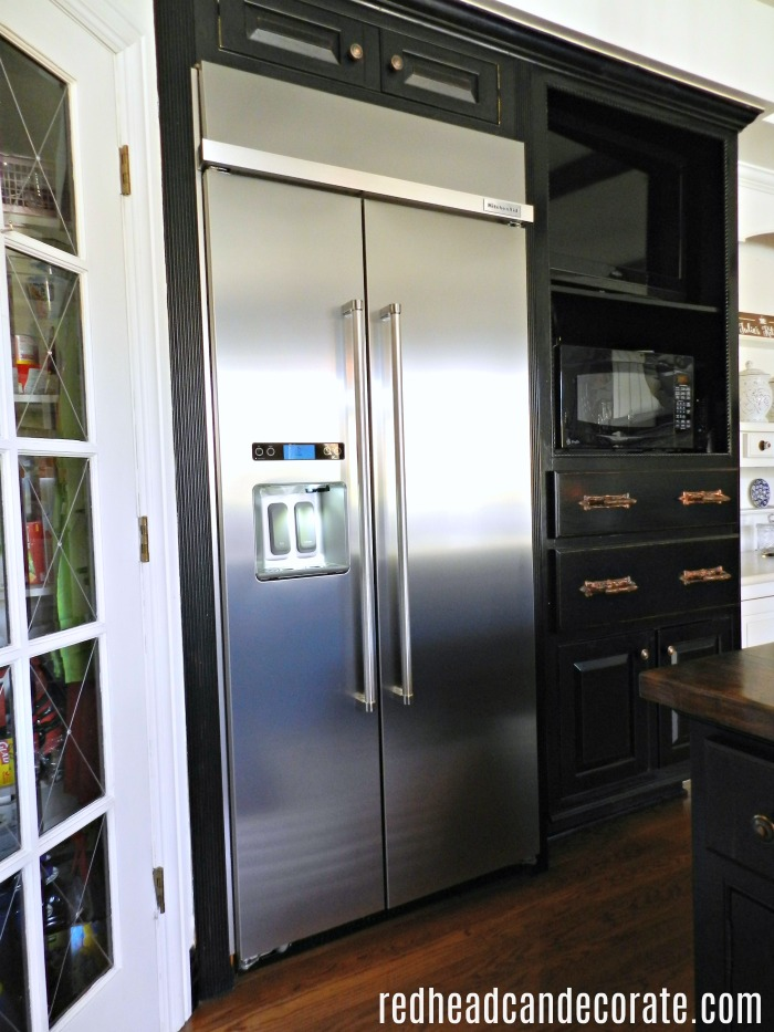 What a beautiful built-in-refrigerator transformation. This 1994 old Sub-Zero refrigerator is replaced with a modern classic kitchen aid stainless steel side by side refrigerator.