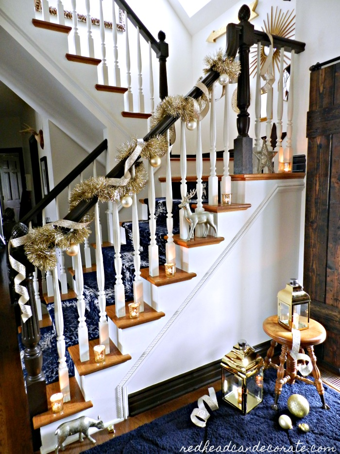 """This beautiful """"Blue & Gold Christmas Staircase"""" was decorated easily using old fashioned gold garland and gold ribbon. The gold lanterns are the icing on the gold cake!"""