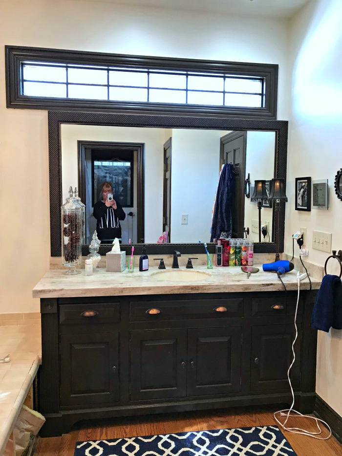 This Michigan Mom grew tired of the dated jacuzzi tub and plain ceramic tile. It was time for an update and a beautiful master bathroom makeover!