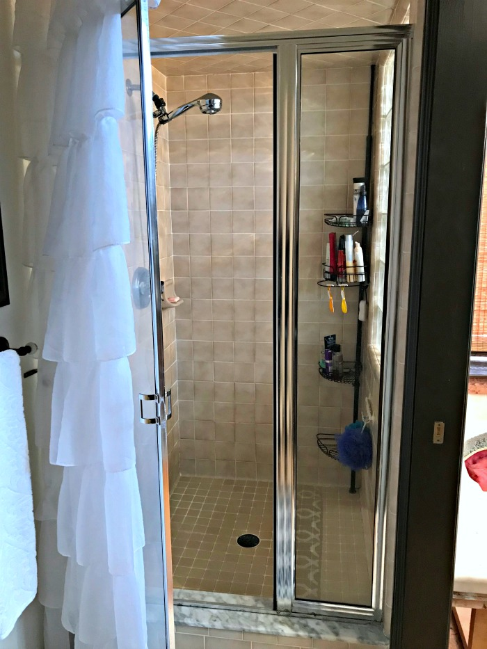 BEFORE PHOTO: A Michigan couple transformed their bathroom with this beautiful Master Bathroom Renovation Shower Reveal!