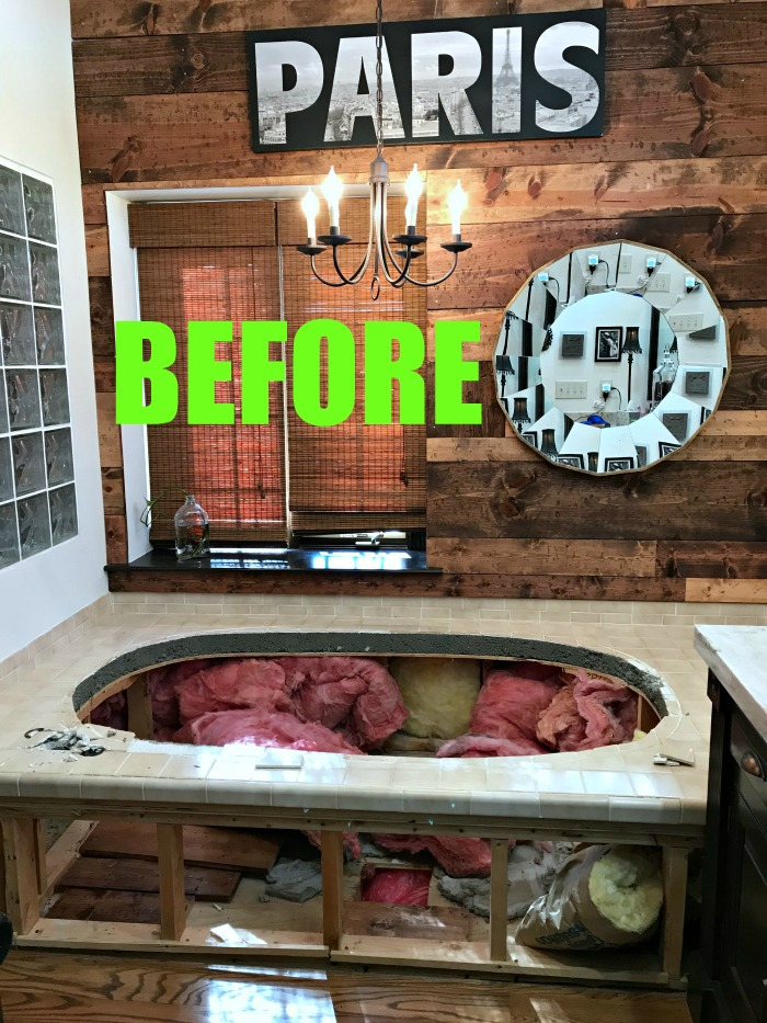 This Michigan DIY blogger and husband removed their dated jacuzzi tub and then transformed their entire master bathroom into a cozy rustic retreat complete with an electric fireplace. A must see! Master Bathroom Renovation-The Full Reveal