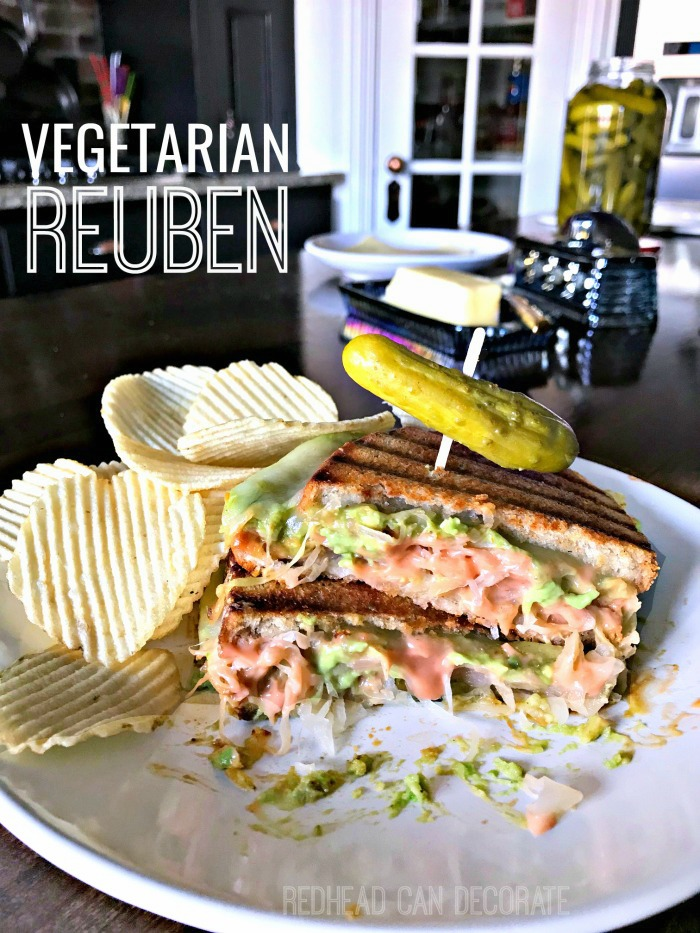 This Vegetarian Reuben Sandwich looks so tasty! It's made with avocado, sauerkraut, Swiss cheese, and homemade thousand island dressing!
