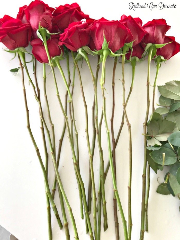 This blogger saved tons of money on her 25 year wedding vow renewal flowers by doing a DIY Rose Wedding Bouquet for both her and her daughter.  She also made the boutonnières!