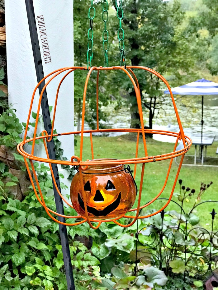 This Dollar Store Hanging Jack-O'-Lantern would look so cute on a porch or lined up on a sidewalk!