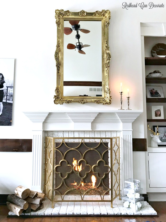 This gorgeous thrift store mirror is a perfect fit for this traditional mantel.  Learn how to hang heavy wall decor with ease!