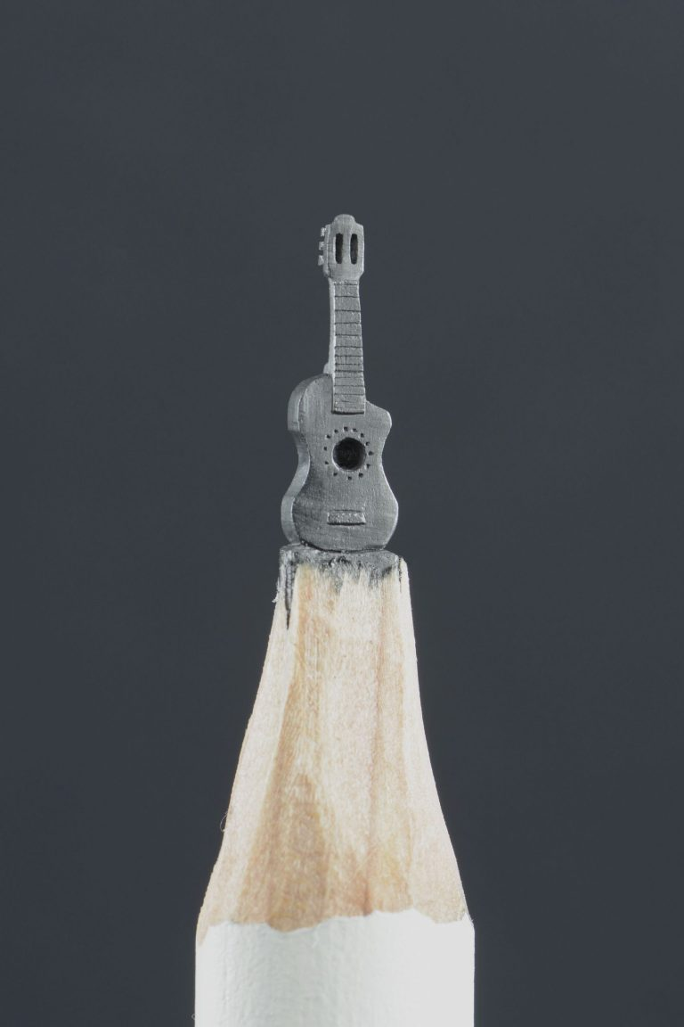 A Micro-carving of a guitar On The Tip Of A Pencil