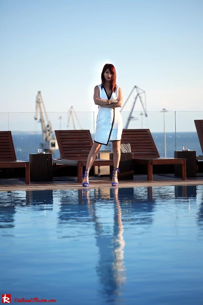Redhead Illusion Beside A Pool