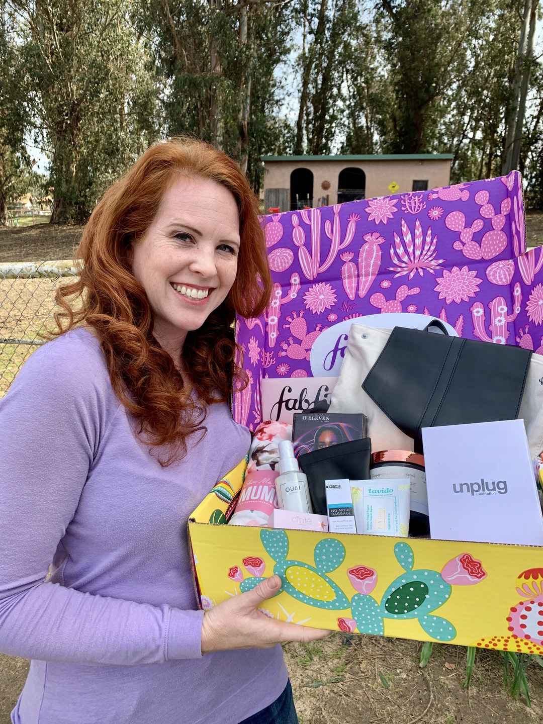 A woman holding a subscription box