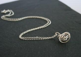 The ever - popular silver wire twist pendant