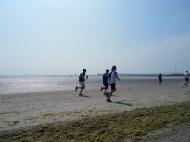Three runners on the beach