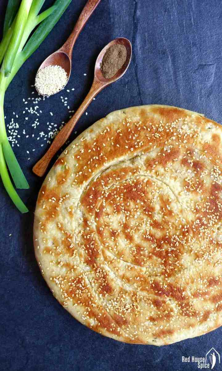 Leavened scallion flatbread topped with sesame seeds