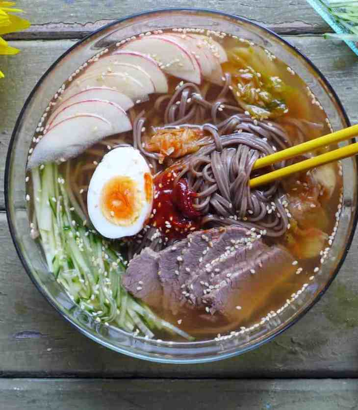 Slippery noodles in ice cold soup, served with various healthy toppings, cold soba noodles in beef broth is a perfect dish to cool you down in hot weather.