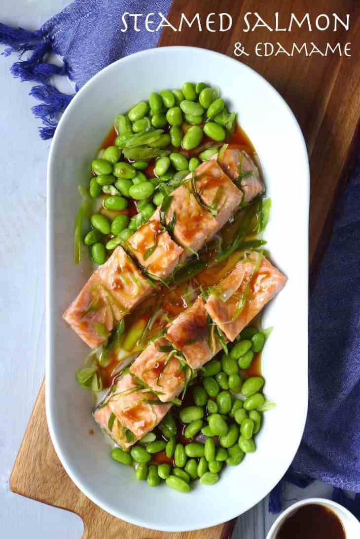 A beautiful plate of steamed salmon seasoned with spring onion oil and accompanied by fresh soy beans.