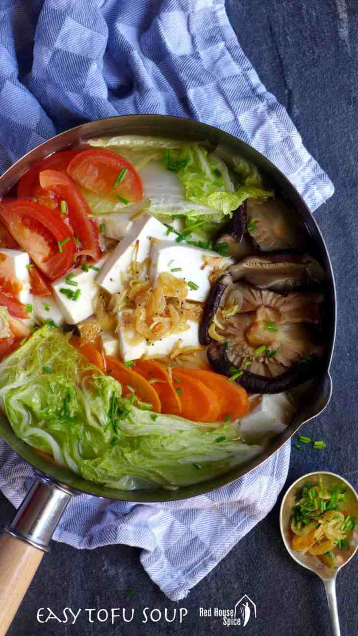 A bowl of tofu soup with various vegetables can be very refreshing and soothing, and the addition of papery dried shrimp makes it even more appealing.