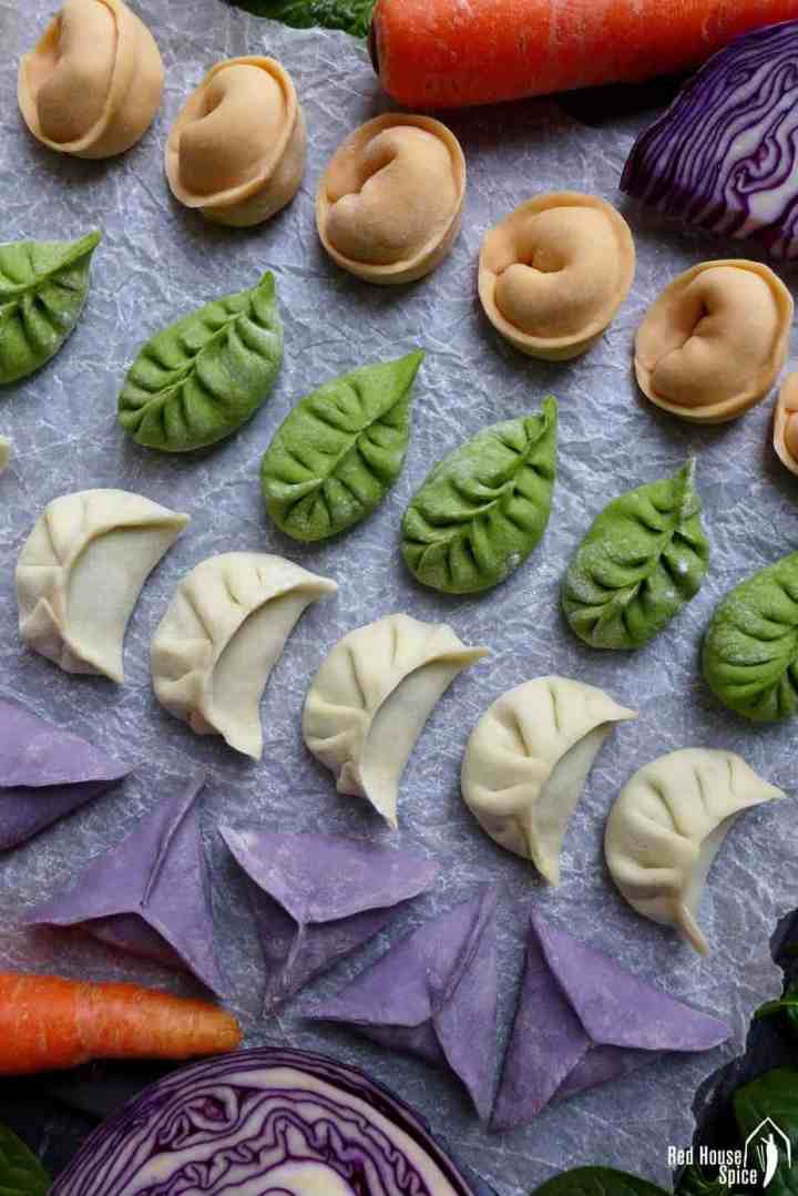 Chinese dumplings in four colours and four shapes.