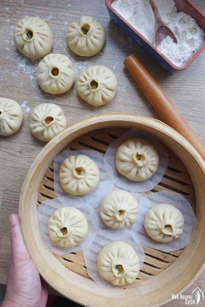 Freshly assembled bao buns ready to be steamed.