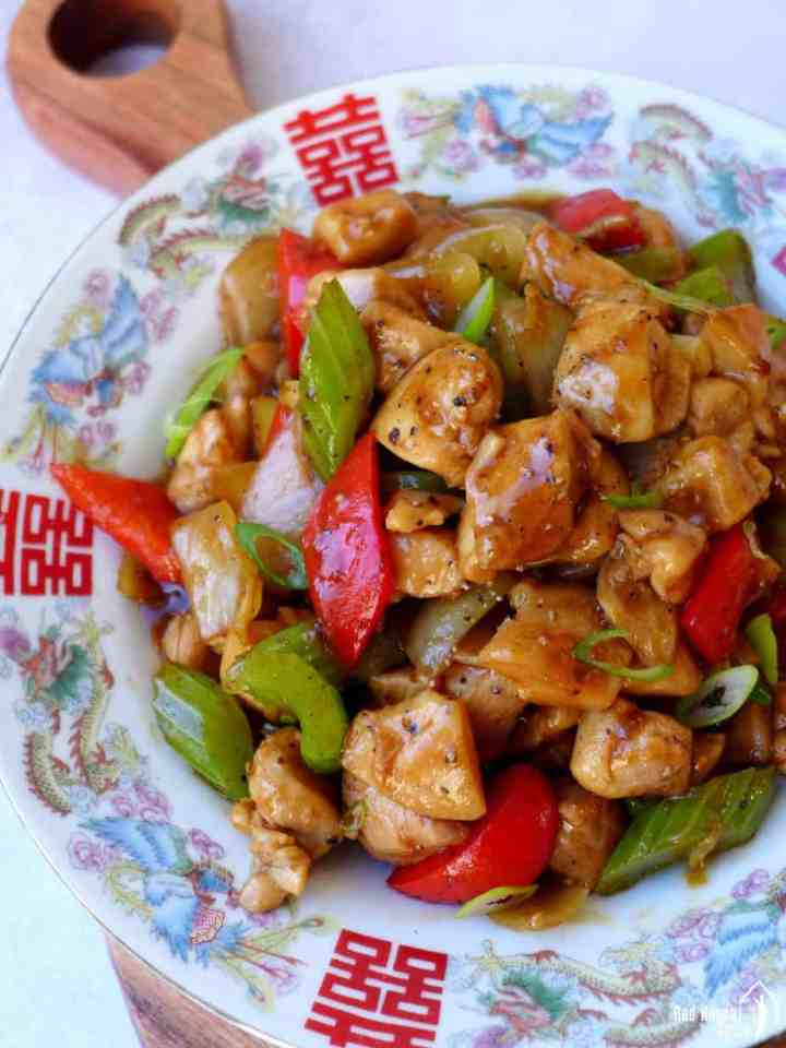 A plate of black pepper chicken stir-fry