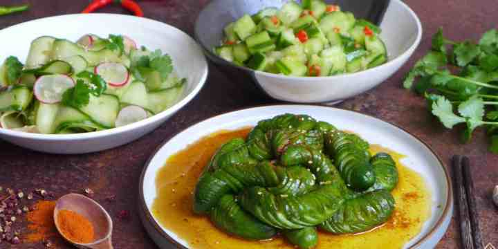 Three plates of cucumber salad