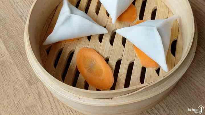 Dumplings over slices of carrot
