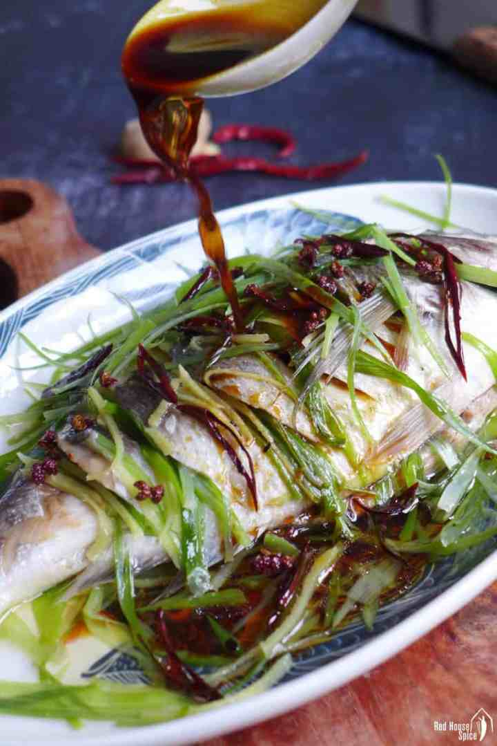 Pouring sauce over steamed fish
