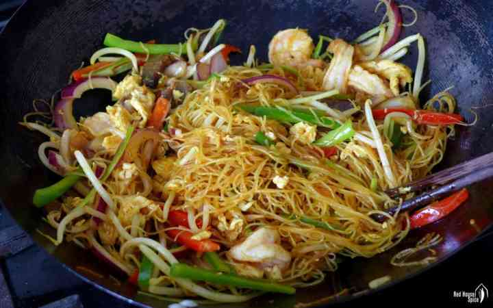 Stir-fried Singapore Noodles in a wok