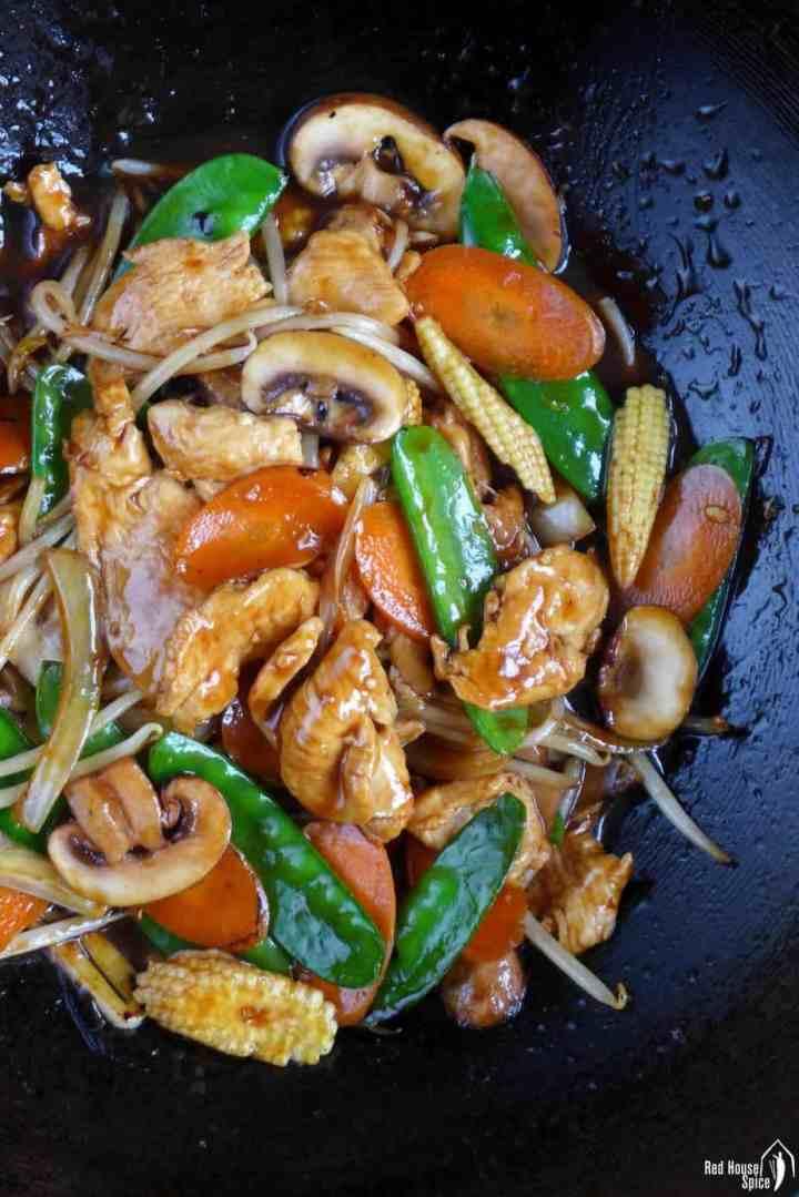 Frying chicken chop suey in a wok