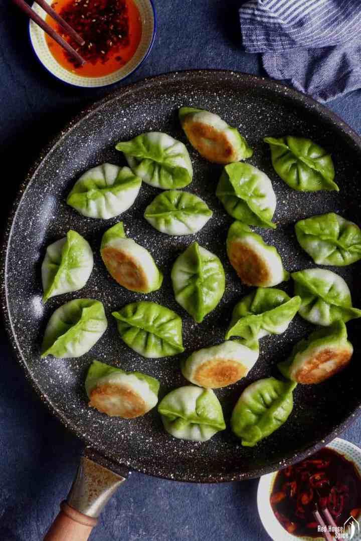Bi-colour vegetarian dumplings in a pan